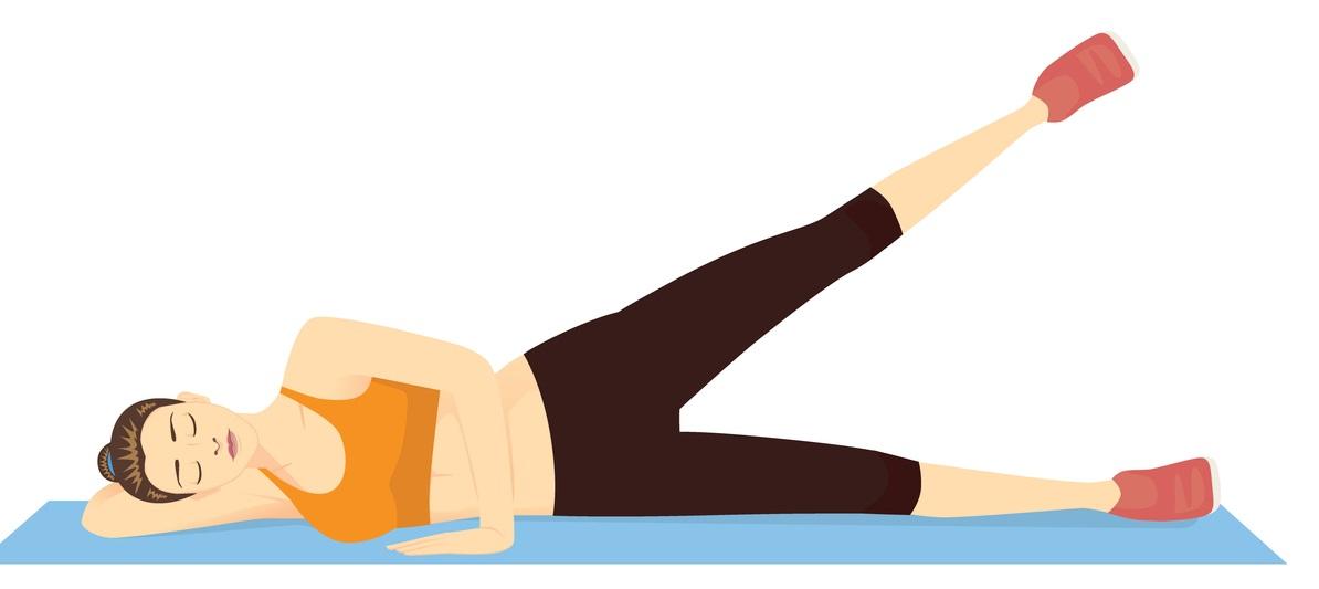 Woman doing leg raise exercise in 2 step on blue mat