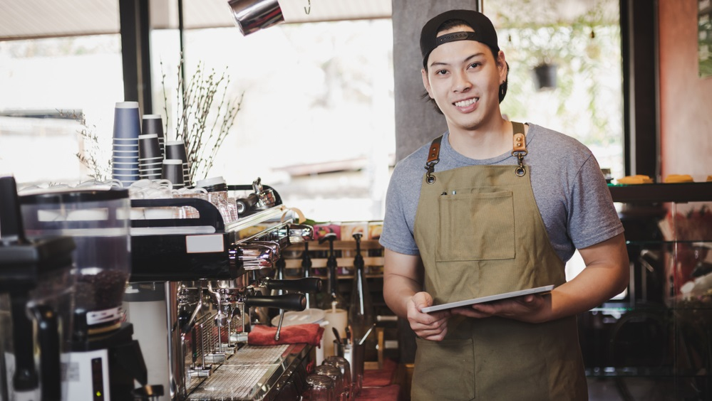 barista holding tablet for checking order